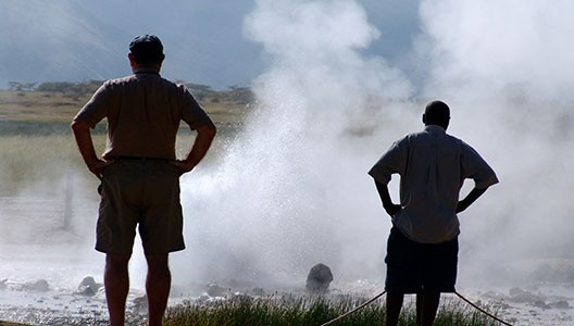 men standing by geysers
