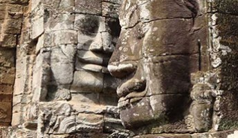 ancient carved stone faces